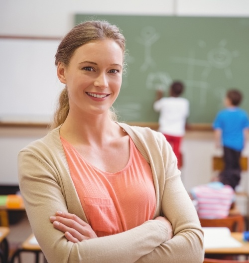 smiling teacher leaning to the left-717873-edited